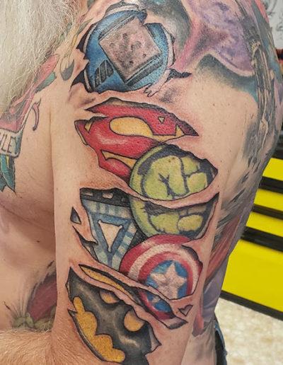 Superhero Emblems Torn Skin Tattoo