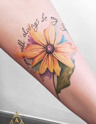 Daisy Watercolor Text Detail Tattoo