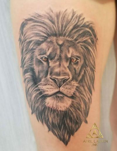 Lion Head Amber Eyes Tattoo